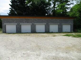Location Garage 13m² Sales (74150) - Photo 1